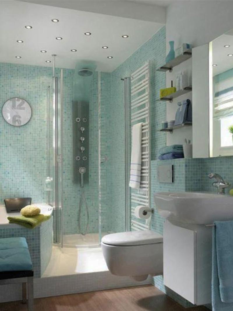 a light blue small bathroom